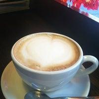 Photo taken at Lucid Cafe by Allan U. on 10/13/2012