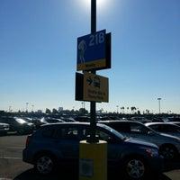 Photo taken at Katella Cast Member Parking Lot (K-Lot) by miguel P. on 10/29/2012