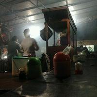 Photo taken at Sate Ayam Ibu Haji Mawi Madura by Astri K. on 10/24/2012