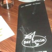 Photo taken at Bar Louie by Vojtěch K. on 12/18/2012