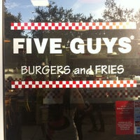Photo taken at Five Guys by Nicole D. on 12/10/2013