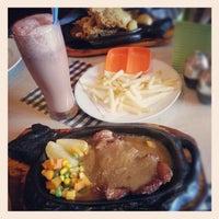 Photo taken at Obonk Steak & Ribs by Vivi T. on 12/29/2012