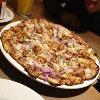 Photo taken at California Pizza Kitchen by Sandra P. on 3/9/2013