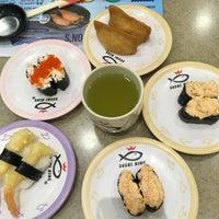 Photo taken at Sushi King by Amira Izzati A. on 9/1/2016