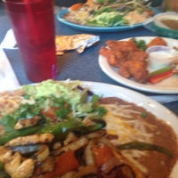 Photo taken at Super Mex by Emily C. on 3/14/2014