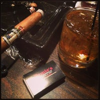 Photo taken at Jamie's Cigar Bar & Restaurant by Mike P. on 3/14/2013