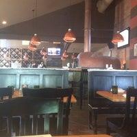 Photo taken at JoJo Bistro & Wine Bar by Eric H. on 5/24/2014