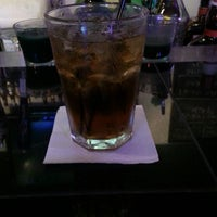 Photo taken at Quinlan's Sports Grill & Bar by Magicc J. on 6/26/2013