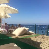 Photo taken at Kırmızı Değirmen Beach by erayz ➰. on 7/27/2016