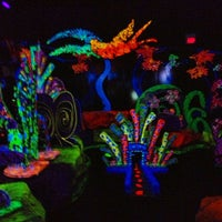 Photo taken at Putting Edge Glow-in-the-Dark Mini Golf by B on 11/4/2012