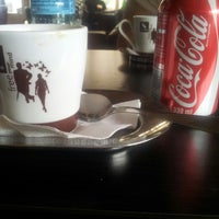 Photo taken at Delicia Caffe by Vasile C. on 4/10/2014