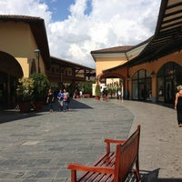 Photo taken at Franciacorta Outlet Village by Alessandro F. on 8/25/2013