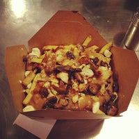 Photo taken at Smoke's Poutinerie by Matthew C. on 12/8/2012