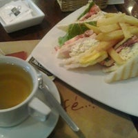 Photo taken at Caramel Café by Carolina A. on 3/6/2014
