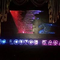 Photo taken at V2 Lounge Bar & Karaoke by Ariel S. on 12/21/2012