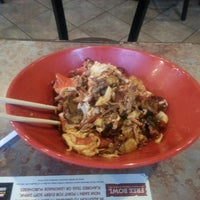 Photo taken at Genghis Grill by Alicia S. on 7/7/2013