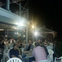 Photo taken at Chelos Waterfront Bar & Grille by Angela S. on 6/9/2013