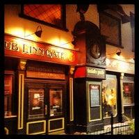 Photo taken at Dub Linn Gate Irish Pub by Andrew G. on 1/8/2013