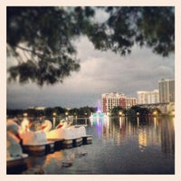 Photo taken at Lake Eola Park by Kate T. on 6/19/2013