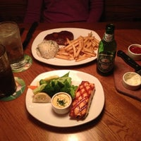 Photo taken at Outback Steakhouse by Erick D. on 11/20/2012