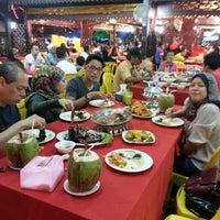 Photo taken at Senibong Village Seafood by Fazlina H. on 3/9/2013