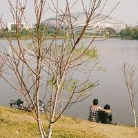 Photo taken at 广州大学城中心湖 by Yoonski K. on 1/17/2014