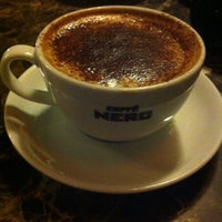 Photo taken at Caffé Nero by Şule Ö. on 1/1/2013