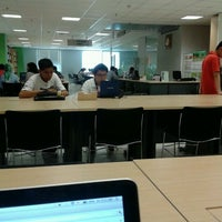 Photo taken at Library BINUS University by Andheisza A. on 9/21/2012