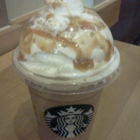 Photo taken at Starbucks by Charissa G. on 10/31/2012
