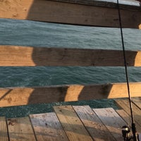 Photo taken at Avon Fishing Pier by Brianna S. on 6/30/2016