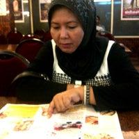 Photo taken at Restoran Lotus (Restaurant) by Liyana J. on 2/21/2013