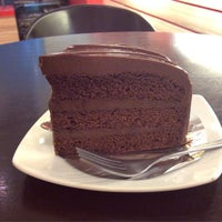 Photo taken at Coffee Me by Sujitporn Coffee & Bakery House by Beer P. on 4/19/2015