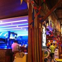 Photo taken at Azuca Latin Bistro by DF C. on 12/8/2012