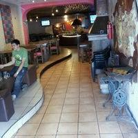 Photo taken at Mongos Lounge & Grill by Renan E. on 10/1/2012