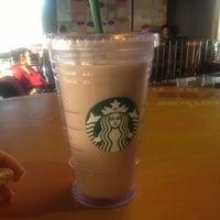 Photo taken at Starbucks by Johana G. on 10/4/2012