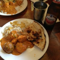 Photo taken at Seva Indian Cuisine by Stephanie P. on 6/15/2013