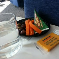 Photo taken at Delta Sky Club by Ju-Lie M. on 4/16/2013