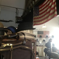 Photo taken at Genuine Motorworks by Claire J S. on 10/13/2013