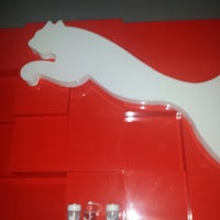 Photo taken at The PUMA Store by Humberto H. on 12/19/2013
