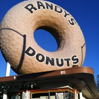 Photo taken at Randy's Donuts by Tim M. on 12/31/2012
