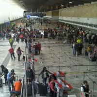 Photo taken at Gate 6 - Aeropuerto El Dorado by Valneide M. on 5/19/2012