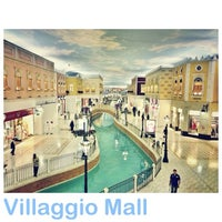 Photo taken at Villaggio Mall by Bu Jojo A. on 6/28/2013