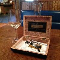 Photo taken at Brown Dog Café & Wine Bar by Sandra F. on 4/21/2013