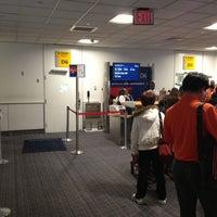 Photo taken at Gate D6 by Chris W. on 4/27/2013