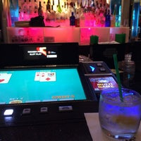 Photo taken at Xhibition Bar by Mary G. on 4/7/2014
