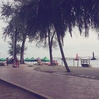 Photo taken at Pantai Teluk Kemang by Meya A. on 7/6/2013