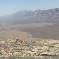 Photo taken at Turtle Head Peak by Joe T. on 6/11/2014