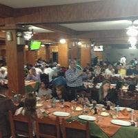 Photo taken at Restaurant El Tiuna by Miguel G. on 5/25/2013