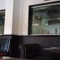 Photo taken at Aromas Cafe by Rahul J. on 10/1/2012