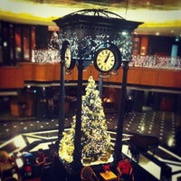 Photo taken at Orchard Hotel by Emily C. on 12/3/2013
